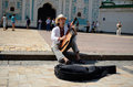 Kiev busker guy playing the bandura at sophia square in ukraine Royalty Free Stock Photos