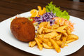 Kiev cutlet with fries Royalty Free Stock Photo