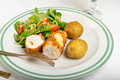 Kiev cutlet with jacket potatoes and salad Royalty Free Stock Photo