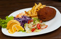 Kiev cutlet with salad Royalty Free Stock Photo