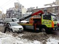 Kiev, March 6, 2018, Ukraine. Traffic police officers on street to pick up intruder`s car on tow truck. Loading tow truck car of Royalty Free Stock Photo