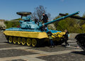 KIEV, UKRAINE - April 17, 2017: Children playing on the tank T 34, Motherland monument, April 17, 2017, Kiev, Ukraine