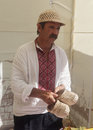 Kiev ukraine august man from the village sells traditional handicrafts fair Royalty Free Stock Image