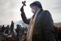Kiev ukraine february mass anti government protests in the center of priest with a cross on independence square after a night Royalty Free Stock Images