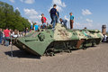 Kiev, Ukraine - May 09, 2016: Children are playing on a damaged armored personnel carrier