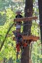 Kiev, Ukraine - September 25, 2015: Girls overcome the obstacle adventure park Royalty Free Stock Photo