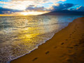 Kihei sunset and beach footprints along beautiful on maui in hawaii Royalty Free Stock Image