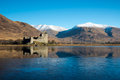 Kilchurn castle and mountains reflecting in loch awe scotland Stock Photos