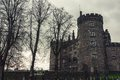 Kilkenny castle and gardens in autumn ireland with heavy clouds it is one of the most visited tourist sites Stock Images