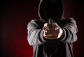Killer with gun close up over dark background Stock Photos
