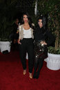 Kim kardashian kourtney kardashian and at the qvc red carpet style party four seasons hotel los angeles ca Stock Photo