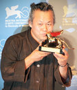 Kim ki duk poses for photographers at th venice film festival on september in venice italy Royalty Free Stock Photo