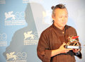 Kim ki duk poses for photographers at th venice film festival on september in venice italy Stock Photography