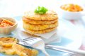 Kimchi potato pancakes pan fried that contain a mixture of mashed potatoes sweet corn kernels cod flesh small cubes of king Stock Photos