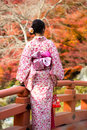 Kimono rear view of japanese girl in a standing in the gardens Stock Photo