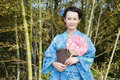 Kimono woman with fan asian bamboo grove Royalty Free Stock Photo