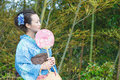 Kimono woman with fan asian bamboo grove Royalty Free Stock Photos