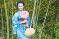 Kimono woman with fan asian bamboo grove Stock Photography
