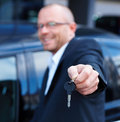 Kind friendly businessman giving car keys Stock Photos