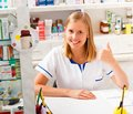 Kind pharmacist young being contented with her occupation Royalty Free Stock Image