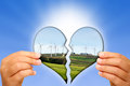 Kind to the environment and clean energy in hands of a little girl with a broken heart an image that represents nature of wind Stock Photo