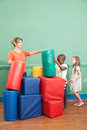 Kindergarden class playing and teacher Royalty Free Stock Photography