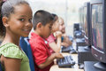 Kindergarten children learning to use computers. Stock Photos