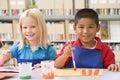 Kindergarten children painting Stock Photo