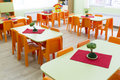 Kindergarten classroom with small chairs and tables Royalty Free Stock Photo