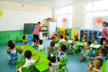 Kindergarten classroom teachers use gestures to children music lessons baixiang county hebei province china aug Royalty Free Stock Image