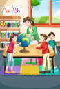 Kindergarten teacher and students Royalty Free Stock Photo