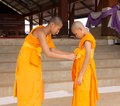 Kindness of the buddhist novice senior help junior dress outer robe a priest Stock Photo