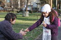 Kindness little girl sharing her sandwich with a homeless man in the park this is really Stock Photo