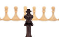 The king against pawns wooden chess piece on chessboard Royalty Free Stock Photo
