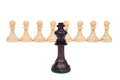 The king against pawns wooden chess piece on chessboard Stock Photos