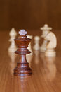 King chess black with white pieces in background Royalty Free Stock Photo