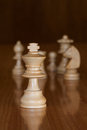 King chess with white pieces in background Stock Photo