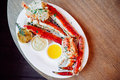 King Crab Cluster with sauces Royalty Free Stock Photo