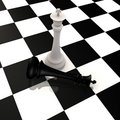 King defeats king in chess game - 3d image Stock Images