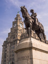 King edward vii and liver building liverpool statue of of the united kingdom with the behind uk Royalty Free Stock Photo