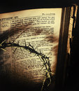 King of the jews retro crown thorns casts dark shadows over an antique th century family bible open to st matthew s recounting Stock Photo