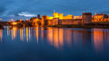 King john s castle ireland historic limerick city reflected in the river shannon at dusk Stock Image