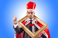 King with picture frame Royalty Free Stock Photo