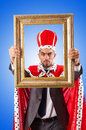 King with picture frame on white Royalty Free Stock Photo