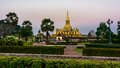 King setthathirat statue and pha that luang stupa in evening great is a gold covered large buddhist in Stock Images