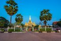 King setthathirat statue and pha that luang stupa in evening great is a gold covered large buddhist in Royalty Free Stock Images