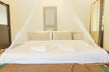 King size bed and net curtains bedrooms Royalty Free Stock Photo