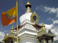 Kings chorten thimpu bhutan the flag of and the stupa of the tomb in thimphu in the kingdom of Royalty Free Stock Photo