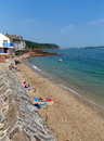 Kingsand beach cornwall england united kingdom on the rame peninsula overlooking plymouth sound holiday makers enjoying summer Stock Image