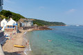 Kingsand cornwall england united kingdom on the rame peninsula overlooking plymouth sound holiday makers enjoying summer heatwave Royalty Free Stock Image